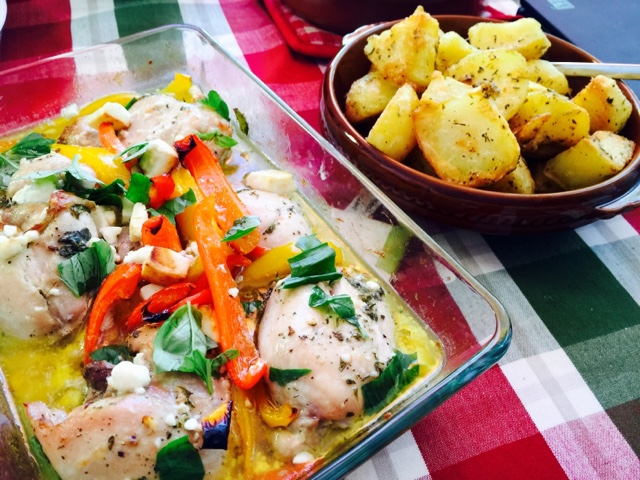 Chicken with lemon, feta and herbs, roast potatoes with Greek herbs