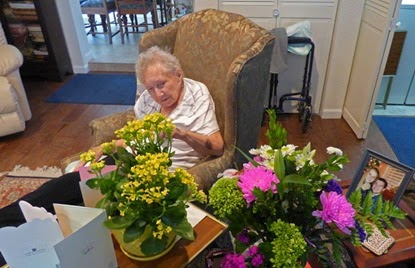 Arny's mother 'Leatta', 92 years old with lots of flowers and candy and smiles