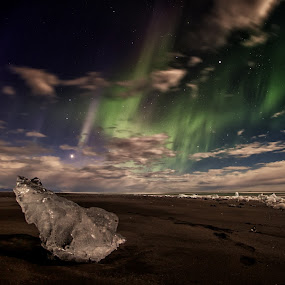 Aurora borealis over the black beach by Tim Vollmer - Landscapes Starscapes ( water, clouds, iceberg, black beach, aurora borealis, northern lights, ocean, iceland, mountains, sky, ice, stars, night )