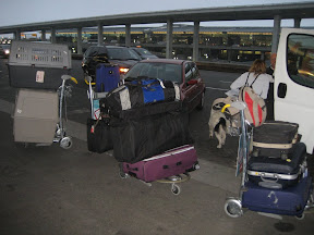 At CDG in Paris. With cat, dog, 6 suitcases, 6 carryons, and a baby!
