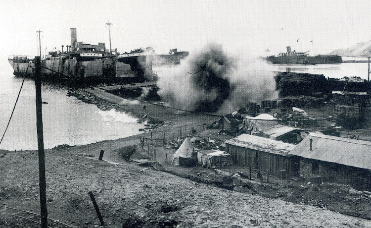 The makeshift assault ship RIVER CLYDE at V Beach, Gallipoli. An exploding Turkish shell underlines the vulnerability of the ship. From the book THE ECLIPSE OF THE BIG GUN. THE WARSHIP 1906-45.jpg