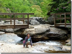 Tricia enjoying the rocks of Second Falls at Graveyard Fields