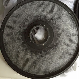 Lint trapped on the removable filter (rotating)