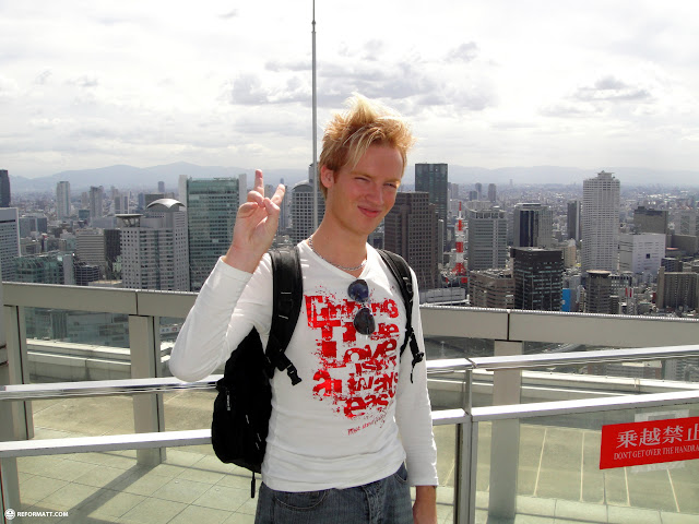 on top of the Umeda sky building with downtown Osaka in the background in Osaka, Osaka, Japan
