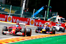 Fernando Alonso in his Ferrari F14T still leads Daniel Ricciardo's Red Bull