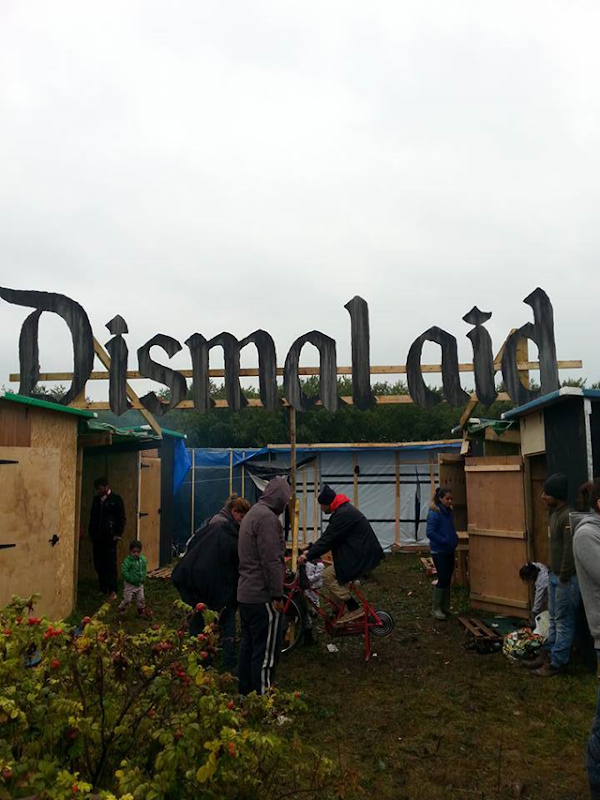 Renowned street artist Banksy is pricking the world's conscience by taking the remnants of a sell-out exhibition to a vast, squalid camp for refugees and migrants in Calais, in northern France. The 'Dismaland' sign was altered to spell out 'Dismal aid' — but it was later torn down. Photo: Lee McGrath / Lincolnshire Aid 2 Calais