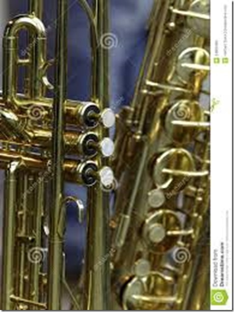 trumpet-saxophone-brass-against-blue-background-34600406 - Copy