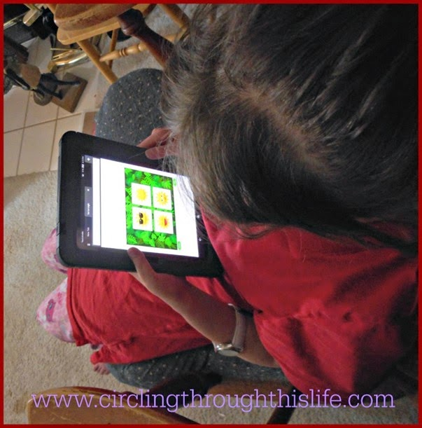 Supergirl using Continuous Mode during her free play time using the Kindle Fire