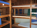 Bunkrooms have wooden bunks with sleeping pads.
