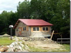 Homemade log cabin using telephone poles
