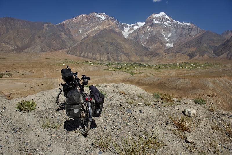 The village of Rusorv, perched at 3000 meters bellow the vertical 6000 meter Lapnazar peak.