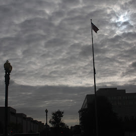 Downtown Shadows by Sam Long - City,  Street & Park  Skylines ( clouds, sky, us american flag, buildings, silhouettes, lamppost, washington dc, shadows, downtown, city )
