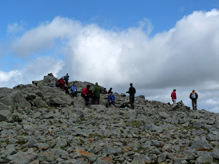 Lots of walkers arrive at the summit of Great Gable