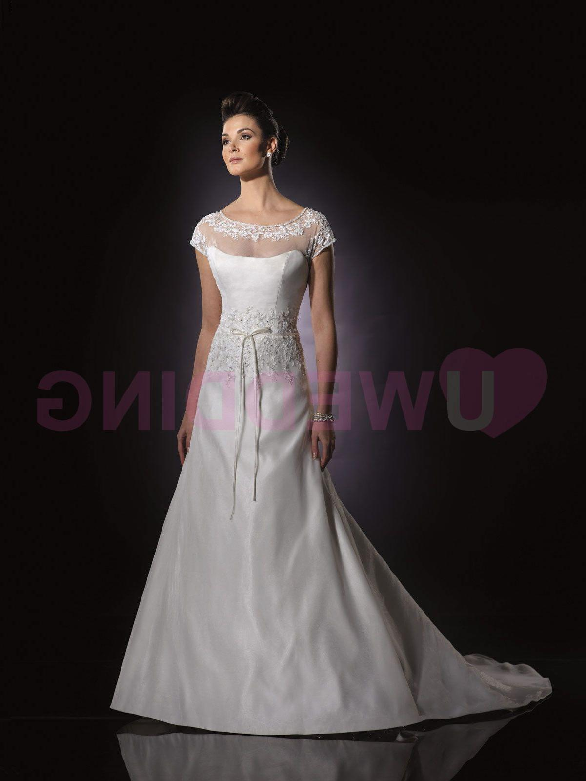 with cap sleeves, illusion back bodice with covered button closures,