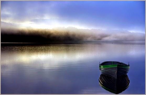 boat-on-misty-lake-316878