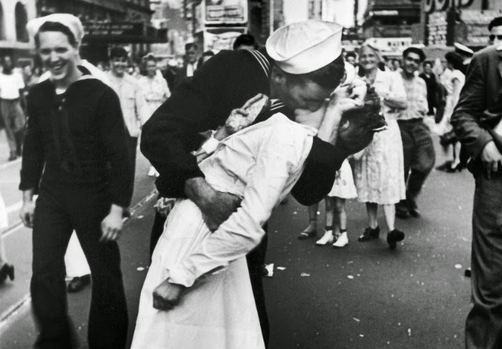 Sailor kissing nurse