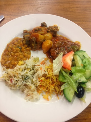 A plate of curry rice and salad at Sanam buffet in Longsight, Manchester