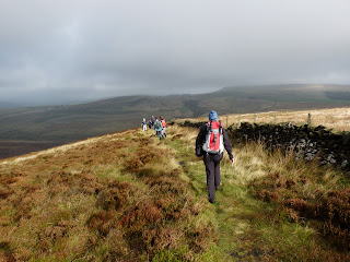 Striding along on Burbage Edge