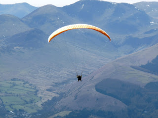A hang glider comes into view