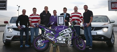 WELLINGBOROUGH, ENGLAND - OCTOBER 12:  Lee Bowers, UK's no.1 freestyle motorbike stunt rider , Ex-England rugby player Lewis Moody and International Stunt Car driver Terry Grant pictured with their World record during a NatWest Rugby World Cup stunt  Fastest Interception at Santa Pod Raceway on October 12, 2015 in Wellingborough, England.  (Photo by Matthew Lewis/Getty Images)