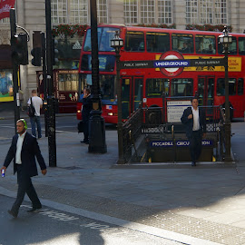 Piccadilly Circus Subway Entrance - London by Dee Haun - City,  Street & Park  Street Scenes ( crosswalk, england, subway entrance, piccadilly circus, red bus, london, 130814$0167rce1, street scene, city )
