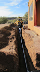 Steve laying drain pipe 2/5