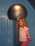 Hannah getting staticky hair at the Magic House in St Louis 03202011b