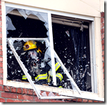 [fireman breaking window]