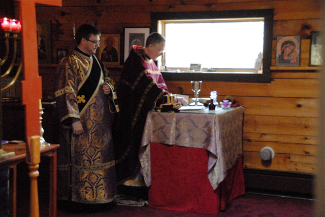 Fr. John and Deacon Gregory prepare the gifts which will be offered for the Eucharist, prior to Liturgy.
