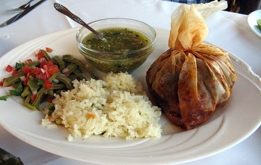 """Mixiote de Cordero, R. Arroz, nopalitos, salsa verde de tomatillos.  The mixiote is a traditional dish of meat with spices steamed or baked on a pouch of the inner membrane of the """"penca"""" of leaf of the maguey. I neglected to ask if it was made with pulque."""