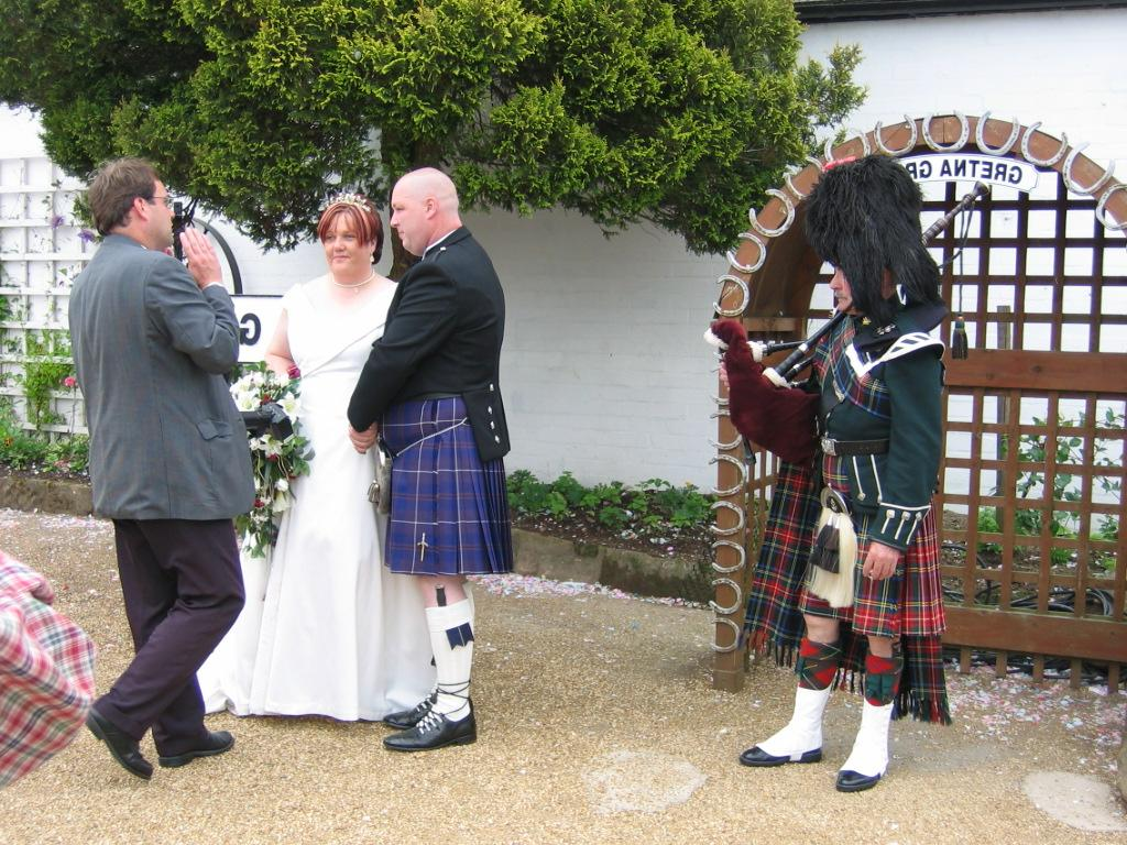 Green wedding bagpiper