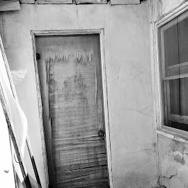 Disrepair by Savannah Eubanks - Buildings & Architecture Decaying & Abandoned ( broken, door, forgotten, window, black and white, abandoned )