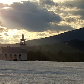Windows of Light  by Chris Cavallo - Instagram & Mobile Android ( clouds, mountains, church, snow, light, golden hour )
