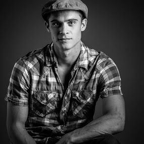 Buy Me by Preston Trauscht - People Portraits of Men ( expression, plad, old, black and white, male, key eyes, witty, young, portrait, hat, eyes, smirk, emotional, stung )