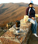 Fialka Grigorova at the top of Hawksbill Mountain, Shenandoah National Park in Virginia.  In front is a pot of coffee brewing.