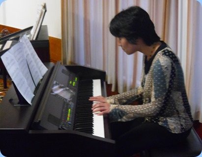 Yuko Tani playing the Club's Clavinova CVP-509.