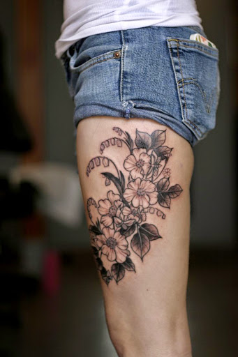You Can Also Get Flower And Quotes Tattoo Combination On Thigh Flowers Tattoos Are Very Famous For Women