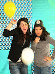 Two of the girls responsible for the successful event, have a little fun in the photo booth