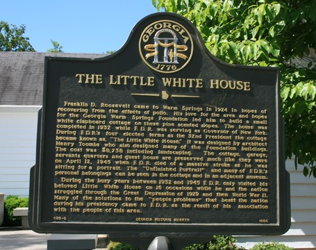 little white house sign