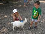 Bryan watching Hannah brush a goat at the Nashville Zoo 09032011a