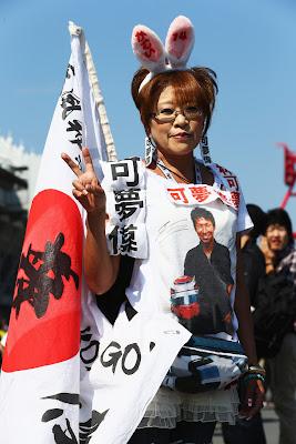 болельщица Камуи Кобаяши с ушками на Гран-при Японии 2012