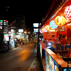 Kata at night by Kristin McMullan - Food & Drink Eating ( dinner, night photography, thailand, dining, night, restaurant, kata, roads )