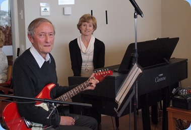 Brian and Denise Gunson kindly came along and entertained us. Brian using his G & L electric guitar and Denise playing the Village's Yamaha Clavinova CVP-609. Photo courtesy of Diane Lyons.