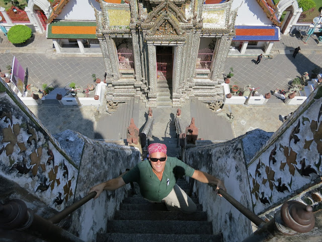Climbing one of the steep staircases at Wat Arun.