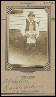 Joseph Niehaus, with one of his Lark family grandsons.  We believe this was taken at the West Street residence.  His daughter, Minnie, wrote on the front of the photo holder.