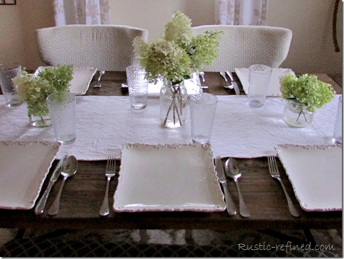 Farmhouse Tablescape Idea using a simple flower arrangement and white dishes
