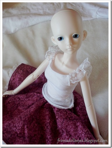 Ball jointed doll in lace top and skirt