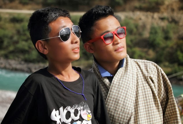 2 Bhutanese boys and their colourful sunglasses