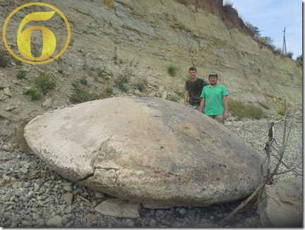 mystery stone disc UFO Russia