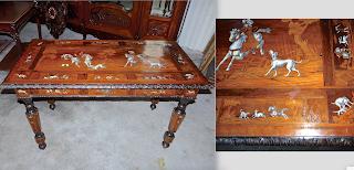 Красивый антикварный стол с сюжетами охоты. ок.1870 г. Ценные породы дерева, маркетри, кость, выдвижной ящик. 124/65/77 см. 5500 евро.
